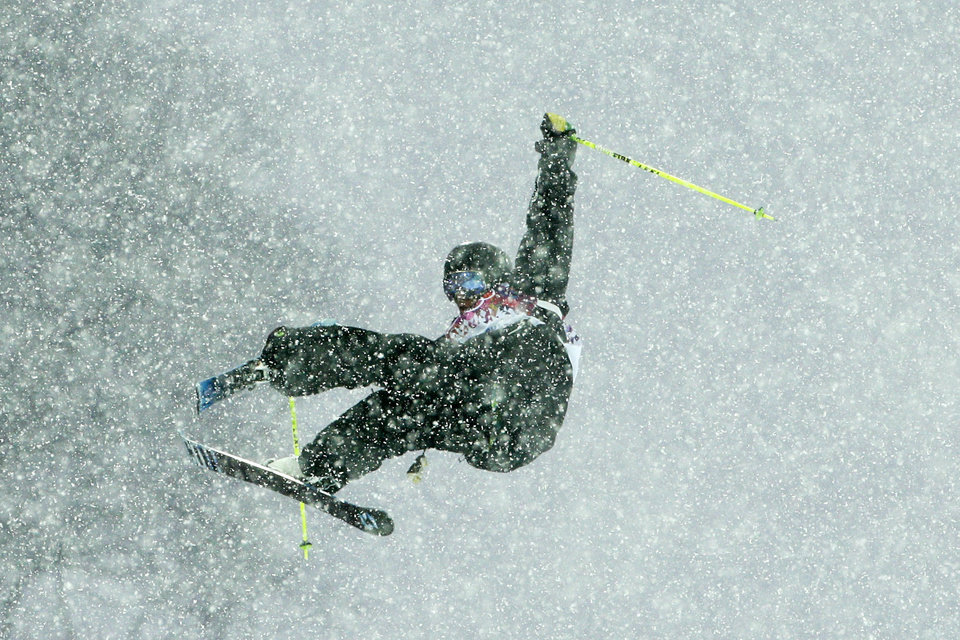 Photo - Austria's Marco Lander catches air during the men's freestyle skiing halfpipe qualification at the Rosa Khutor Extreme Park, at the 2014 Winter Olympics, Tuesday, Feb. 18, 2014, in Krasnaya Polyana, Russia. (AP Photo/Jae C. Hong)