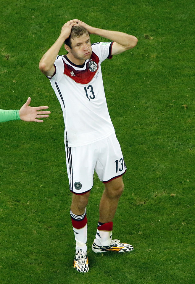 Photo - Germany's Thomas Mueller reacts after failing to score during the World Cup round of 16 soccer match between Germany and Algeria at the Estadio Beira-Rio in Porto Alegre, Brazil, Monday, June 30, 2014. (AP Photo/Fabrizio Bensch, pool)