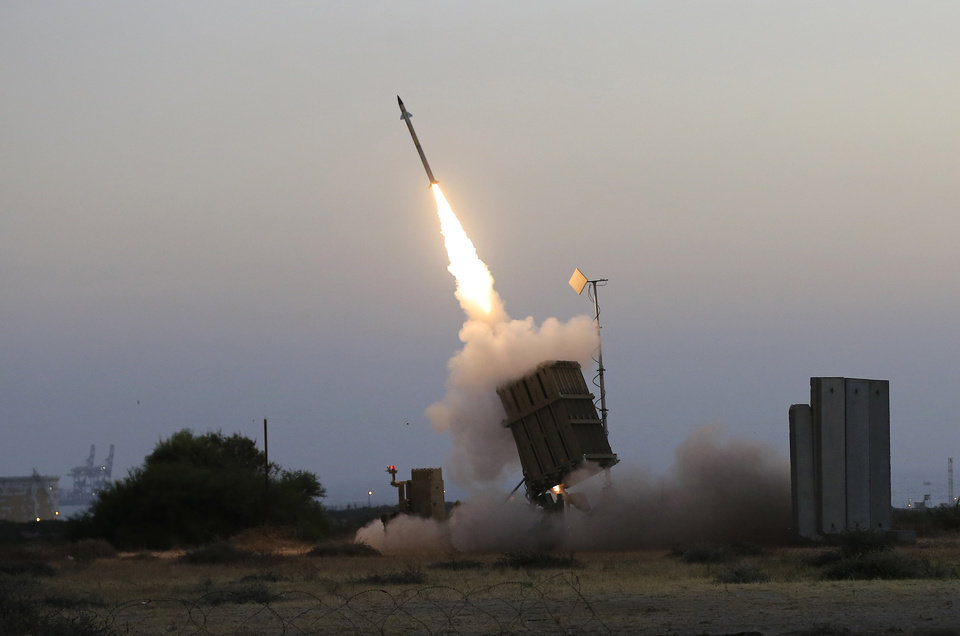 "Photo - An Iron Dome air defense system fires to intercept a rocket from Gaza Strip in the costal city of Ashkelon, Israel, Saturday, July 5, 2014. The Israeli military said its ""Iron Dome"" defense system intercepted the rockets that were aimed at Beersheba. The military also said at least 29 other rockets and mortars were fired from the Gaza Strip at Israel over the weekend. It said it had retaliated with airstrikes on militant sites in Gaza. (AP Photo/Tsafrir Abayov)"