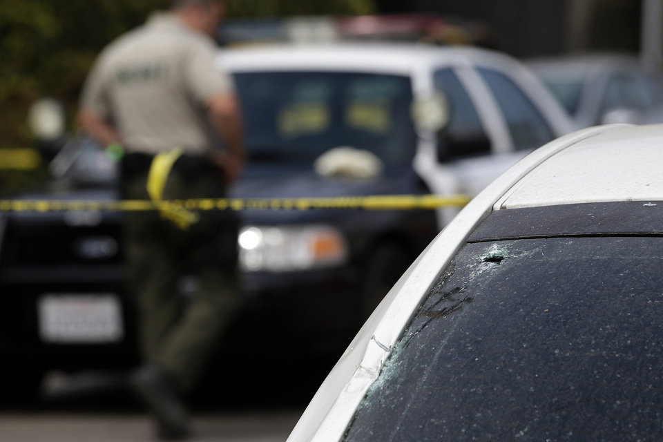Photo - This photo shows the windshield of a car that was shattered by a bullet at the scene of a shooting on Saturday, May 24, 2014, in Isla Vista, Calif. A drive-by shooter went on a rampage near a Santa Barbara university campus that left seven people dead, including the attacker, and others wounded, authorities said Saturday. (AP Photo/Jae C. Hong)