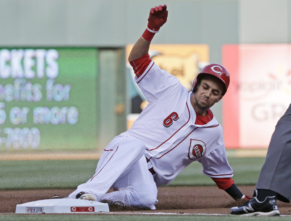 Photo - Cincinnati Reds' Billy Hamilton slides into third base with a triple off San Diego Padres starting pitcher Andrew Cashner in the first inning of a baseball game, Tuesday, May 13, 2014, in Cincinnati. (AP Photo)