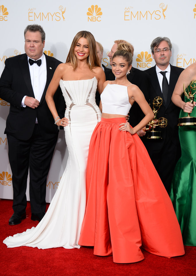 Photo - Sofia Vergara, left, and Sarah Hyland pose with the award for Outstanding Comedy Series in the press room at the 66th Annual Primetime Emmy Awards at the Nokia Theatre L.A. Live on Monday, Aug. 25, 2014, in Los Angeles. (Photo by Jordan Strauss/Invision/AP)