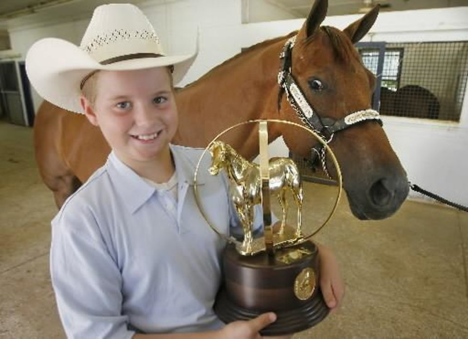 Austin Halvorson with his trophy and horse he won the AQHYA with on his family\'s farm near Guthrie, August, 12, 2008. Photo by David McDaniel,