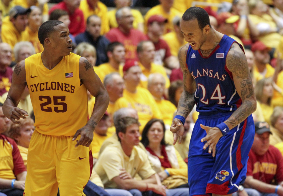 Kansas guard Travis Releford (24) celebrates after a three pointer as Iowa State guard Tyrus McGee (25) watches during overtime of an NCAA college basketball game Monday, Feb. 25, 2013, at Hilton Coliseum in Ames, Iowa. Kansas won the game 108-96. (AP Photo/Justin Hayworth)