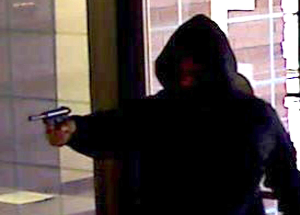 Around 9:30 a.m. Friday, two men entered the Bank of Oklahoma at 4324 SE 44  with guns drawn yelling for cashiers to hand over the money. Cashiers complied and put the money into a black backpack. Both robbers fled and were last seen heading south on foot. Nobody was injured, the Federal Bureau of Investigation reports. <strong>PROVIDED</strong>