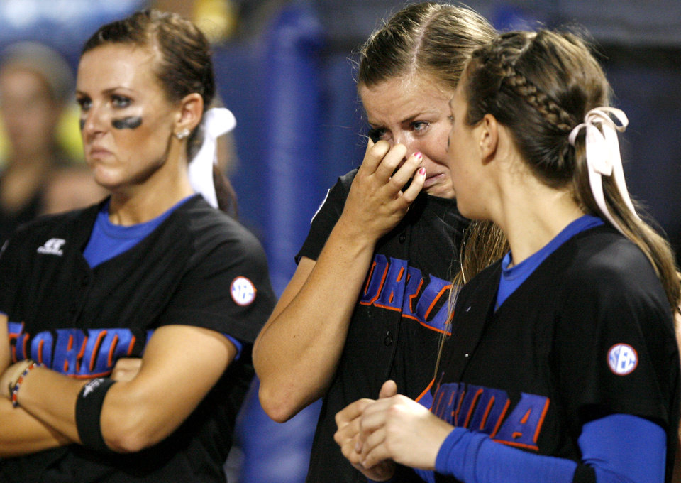 Photo - Florida's Stacey Nelson, center, cries after their 3-2 loss in the second softball game of the championship series between Washington and Florida in Women's College World Series at ASA Hall of Fame Stadium in Oklahoma City, Tuesday, June 2, 2009. Photo by Bryan Terry, The Oklahoman