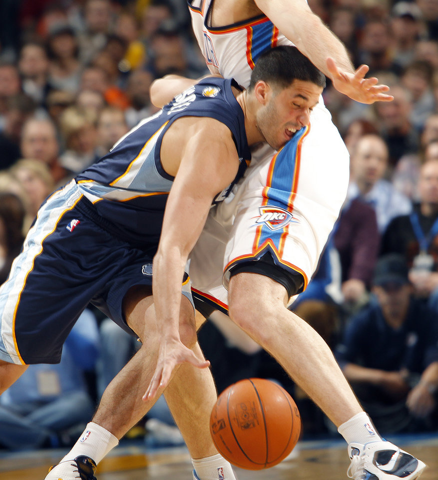 Memphis' Greivis Vasquez (21) runs in to the Thunder's Nenad Krstic (12) during the NBA basketball game between the Oklahoma City Thunder and the Memphis Grizzlies at the Oklahoma City Arena on Tuesday, Feb. 8, 2011, Oklahoma City, Okla.