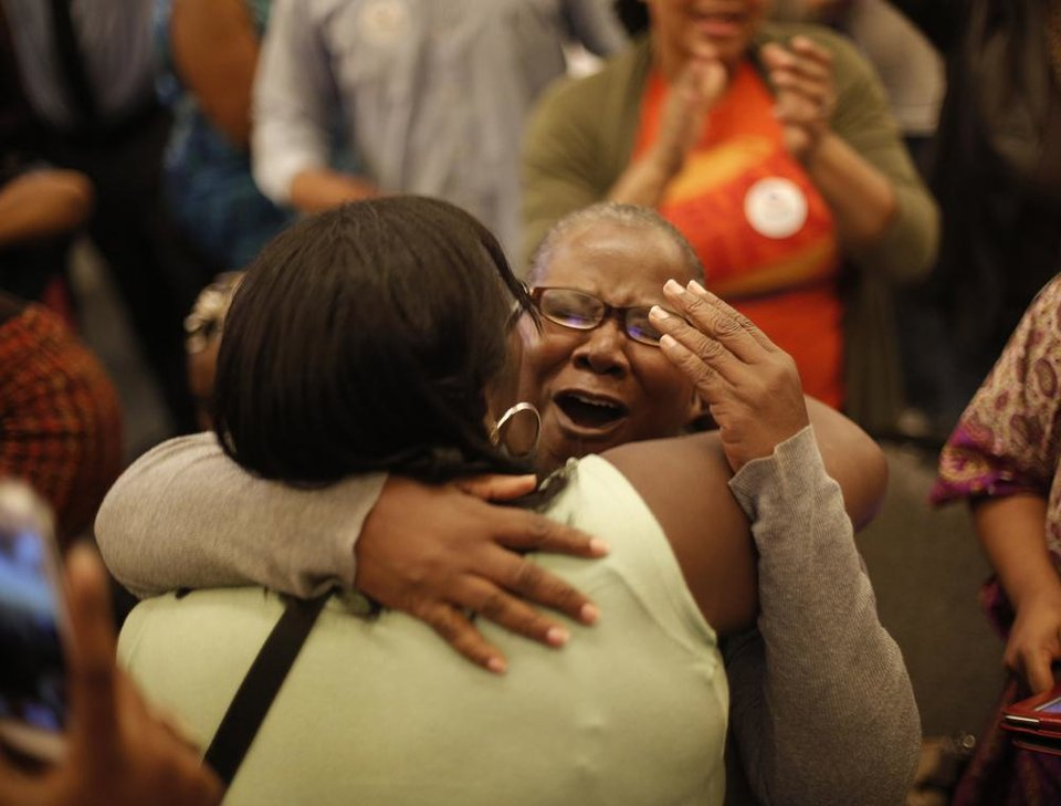 Debra Yarbrough hugs Sonja Foxx after President Obama won the 2012 election during the Oklahoma Democratic Party watch gathering at the Reed Center in Midwest City, Tuesday, Nov. 6, 2012.  Photo by Garett Fisbeck, The Oklahoman