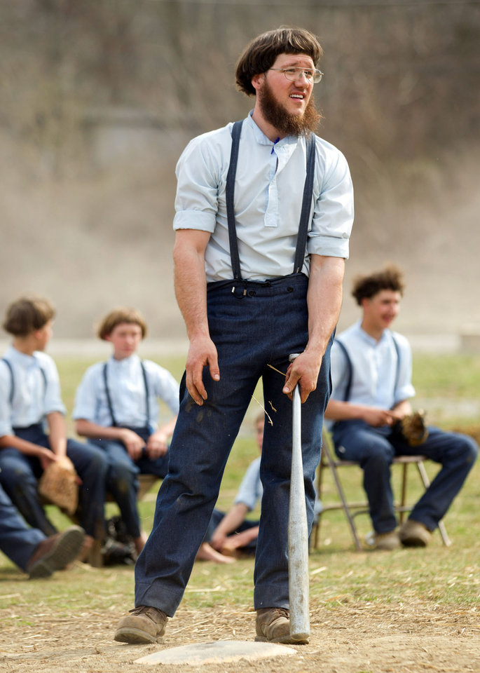 Freeman Burkholder waits for his at bat during a game of baseball at the farewell picnic in Bergholz, Ohio on Tuesday, April 9, 2013.  The picnic was for Burkholder and other Amish people leaving for prison this week for their part in the hair and beard cutting scandal against other Amish members.  (AP Photo/Scott R. Galvin)