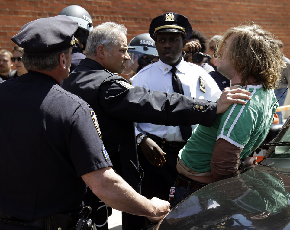 A man is arrested by police during a May Day march in New York, Wednesday, May 1, 2013. Activists in New York City are protesting working conditions, immigration reform and other issues. (AP Photo/Seth Wenig)