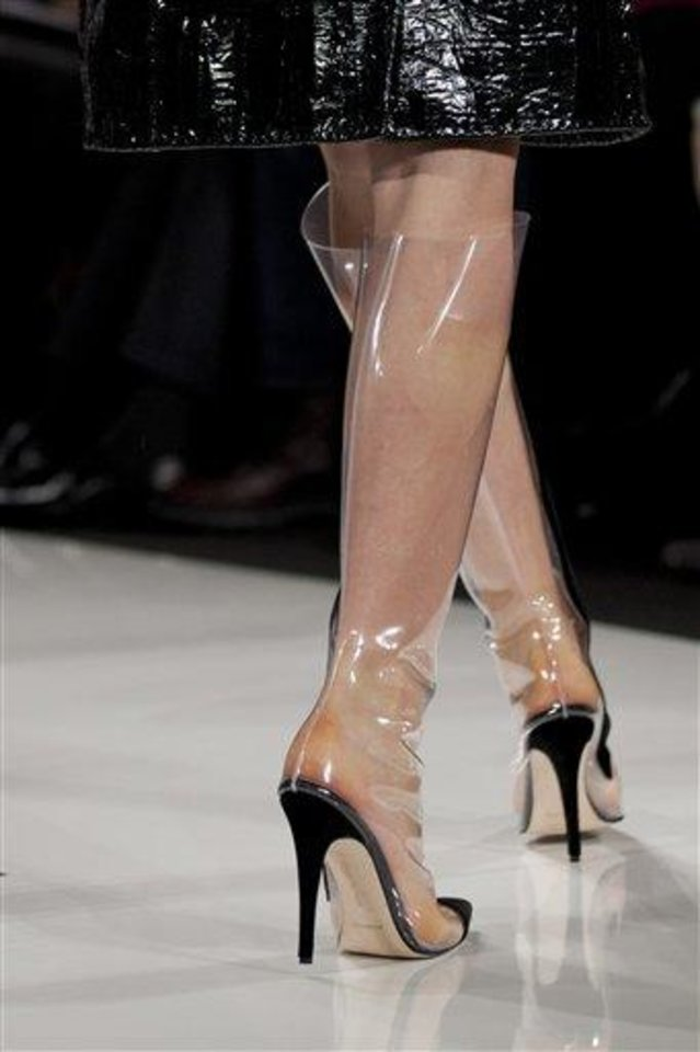 Photo - FILE - This Feb. 10, 2013 file photo shows a model wearing clear boots as she walks the runway during the Ralph Rucci Fall 2013 fashion show during Fashion Week in New York. As New York Fashion Week's fall previews wrapped up Thursday, designers didn't ignore the feet.  (AP Photo/Karly Domb Sadof, file)