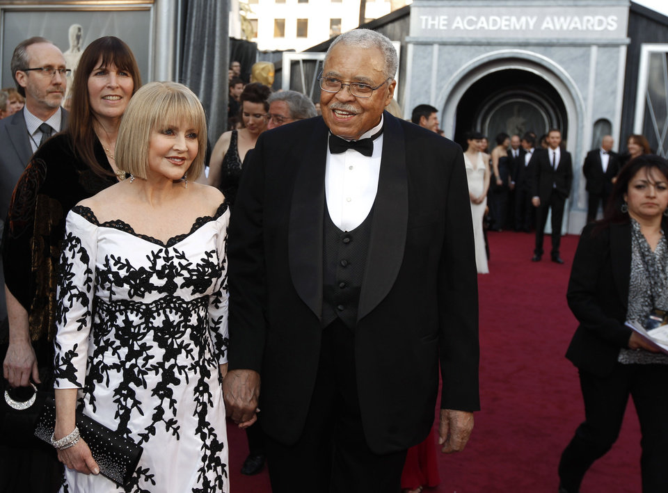 James Earl Jones, right, and Cecilia Hart arrive before the 84th Academy Awards on Sunday, Feb. 26, 2012, in the Hollywood section of Los Angeles. (AP Photo/Chris Carlson) ORG XMIT: OSC375