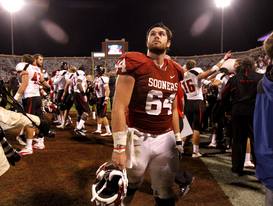 Oklahoma\'s Gabe Ikard (64) walks off the dield after the college football game between the University of Oklahoma Sooners (OU) and the Texas Tech University Red Raiders (TTU) at Gaylord Family-Oklahoma Memorial Stadium in Norman, Okla., Sunday, Oct. 23, 2011. Photo by Bryan Terry, The Oklahoman