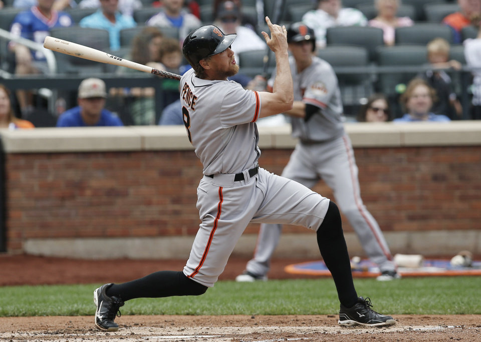 Photo - San Francisco Giants' Hunter Pence hits a third-inning, two-run home run off New York Mets starting pitcher Bartolo Colon in a baseball game in New York, Sunday, Aug. 3, 2014. (AP Photo/Kathy Willens)