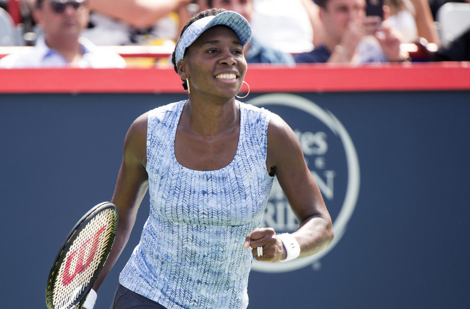 Photo - Venus Williams celebrates after defeating Anastasia Pavlyuchenkova, of Russia, in a first round match at the Rogers Cup tennis tournament in Montreal on Tuesday, Aug. 5, 2014. (AP Photo/The Canadian Press, Paul Chiasson)