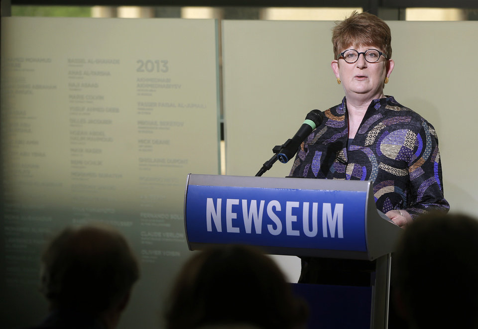 Photo - Associated Press Executive Editor and Senior Vice President Kathleen Carroll speaks at the rededication of the Journalists Memorial at the Newseum in Washington, Monday, June 9, 2014. The memorial, which recognizes journalists killed while covering the news, added 10 names of journalists who were killed in 2013. (AP Photo/Charles Dharapak)
