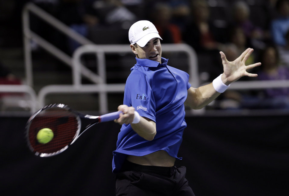 John Isner, of the United States, returns to Xavier Malisse, of Belgium, during the quarterfinals of the SAP Open tennis tournament in San Jose, Calif., Friday Feb. 15, 2013. Isner won 7-6 (8), 6-2.(AP Photo/Marcio Jose Sanchez)