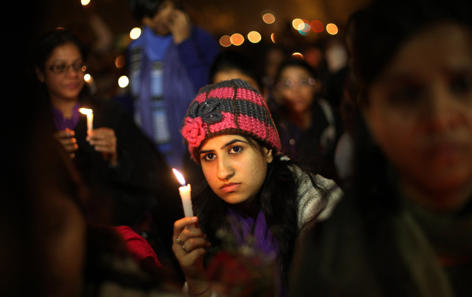 Photo - Indians participate in a candle lit vigil to mourn the death of a gang rape victim in New Delhi, India , Saturday, Dec. 29, 2012. Indian police charged six men with murder on Saturday, adding to accusations that they beat and gang-raped the woman on a New Delhi bus nearly two weeks ago in a case that shocked the country. The murder charges were laid after the woman died earlier Saturday in a Singapore hospital where she has been flown for treatment. (AP Photo/Altaf Qadri)