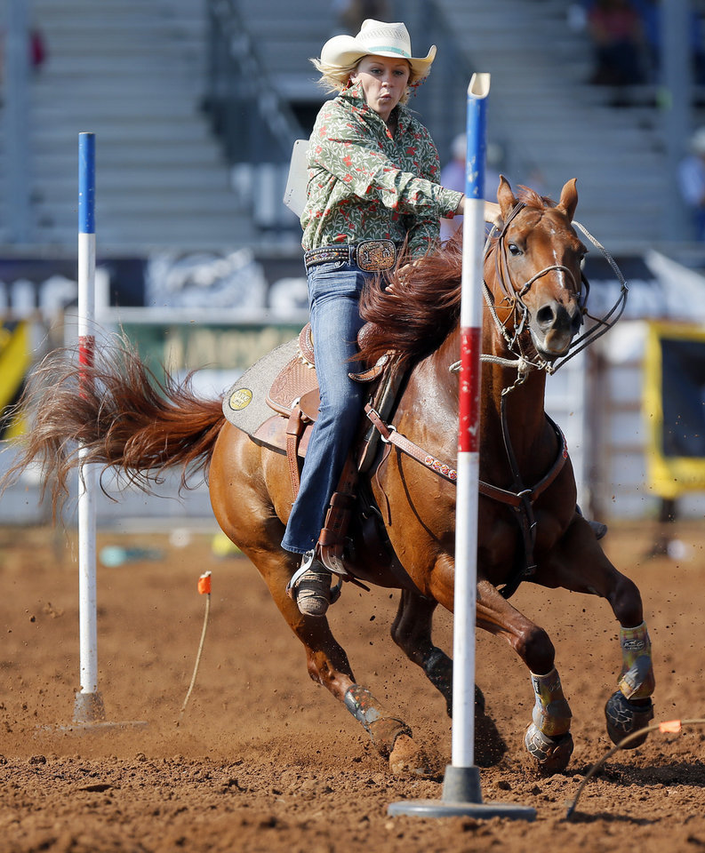 Priscilla Pickett of Johnson City, Texas, competes in pole bender during the International Finals Youth Rodeo at the Heart of Oklahoma Exposition Center in Shawnee, Okla., Thursday, July 12, 2012. Photo by Nate Billings, The Oklahoman