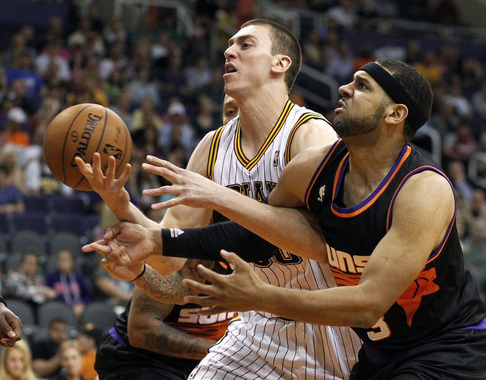 Photo - Indiana Pacers forward Tyler Hansbrough, left, battles Phoenix Suns forward Jared Dudley, right, for the loose ball during the first half of an NBA basketball game, Saturday, March 30, 21013, in Phoenix. (AP Photo/Paul Connors)