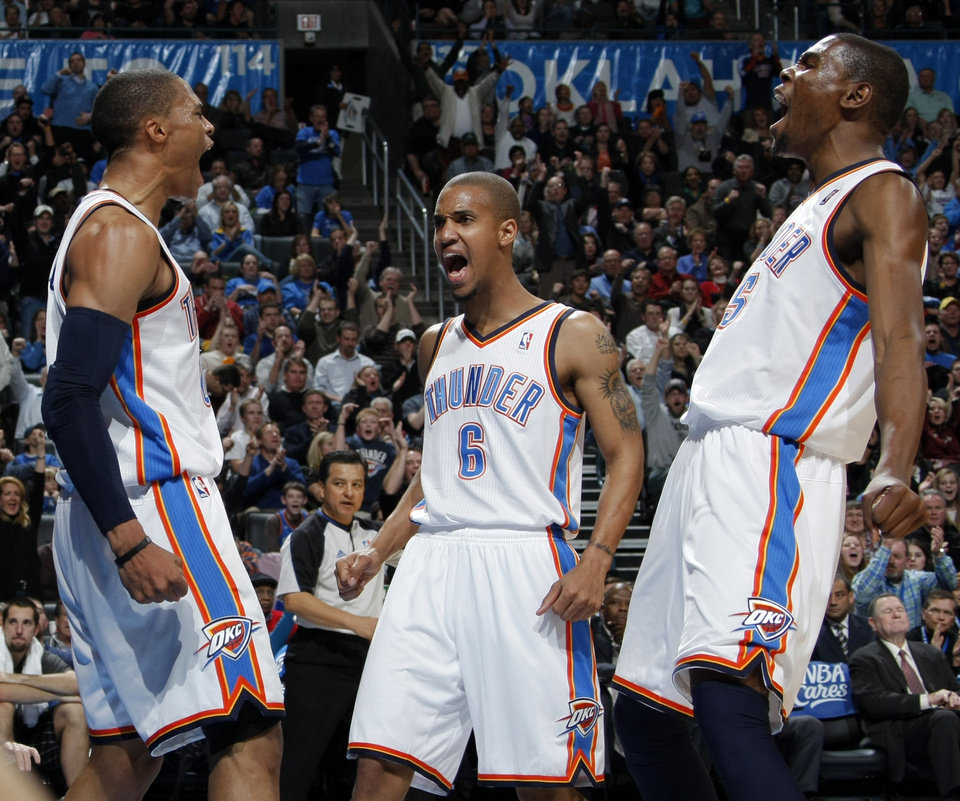 Photo - From left, Oklahoma City's Russell Westbrook (0), Eric Maynor (6) and Kevin Durant (35) react after Westbrook made a shot and was fouled in the fourth quarter during the NBA basketball game between the Orlando Magic and Oklahoma City Thunder in Oklahoma City, Thursday, January 13, 2011. Oklahoma City won, 125-124. Photo by Nate Billings, The Oklahoman