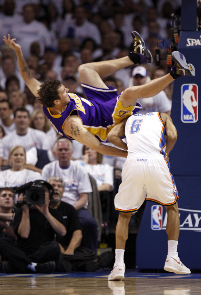 L.A.'s Luke Walton (4) flips over Eric Maynor (6) during the NBA basketball game between the Los Angeles Lakers and the Oklahoma City Thunder in the first round of the NBA playoffs at the Ford Center in Oklahoma City, Saturday, April 24, 2010. Photo by Sarah Phipps, The Oklahoman