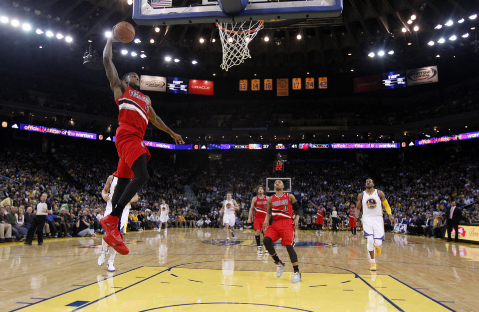 Photo - Portland Trail Blazers' Thomas Robinson goes up for a dunk against the Golden State Warriors during the first half of an NBA basketball game on Sunday, Jan. 26, 2014, in Oakland, Calif. (AP Photo/Marcio Jose Sanchez)