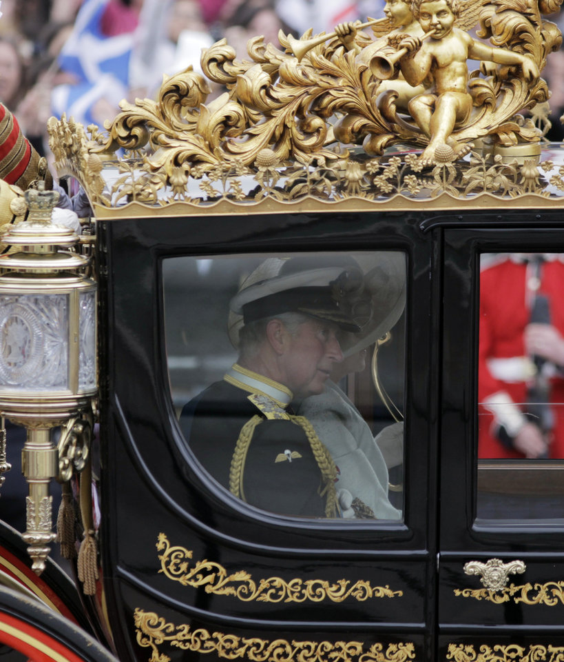 Photo - Britain's Prince Charles and Camilla, Duchess of Cornwall ride in a carriage to Buckingham Palace after the Royal Wedding for Britain's Prince William and his wife Kate, Duchess of Cambridge in London Friday, April, 29, 2011. (AP Photo/Lefteris Pitarakis) ORG XMIT: RWMG175