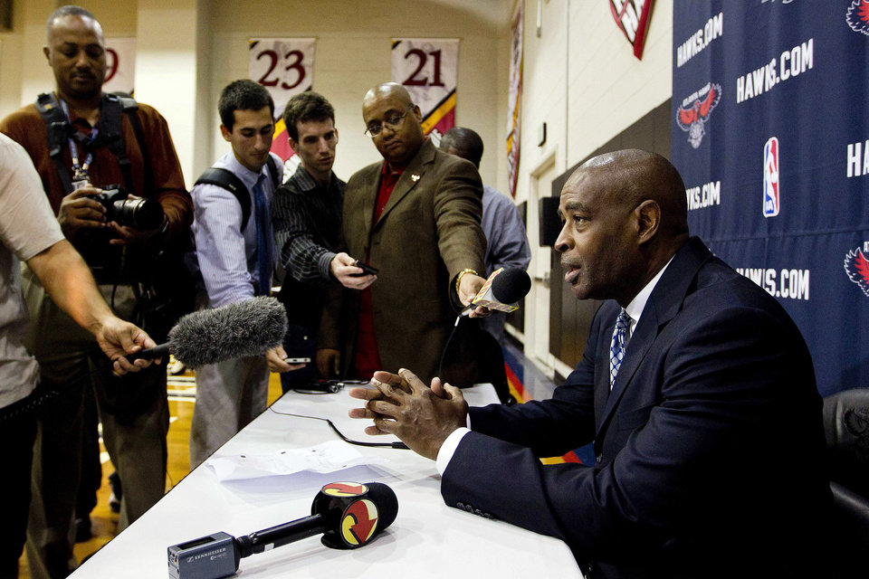 Atlanta Hawks head coach Larry Drew talks to reporters during their NBA basketball media day, Monday, Oct. 1, 2012, in Atlanta. (AP Photo/John Bazemore)