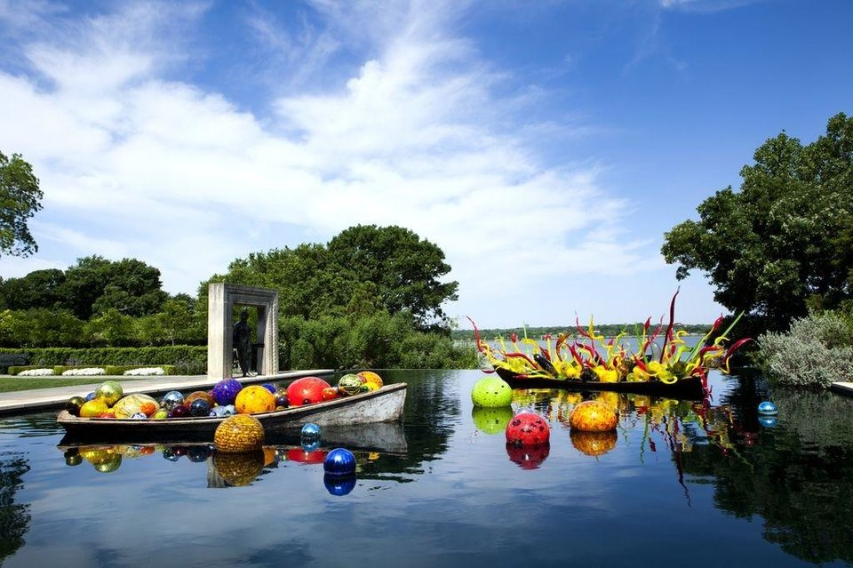 Dale Chihuly art glass is displayed in a pond on the grounds of the Dallas Arboretum. While Oklahomans may be used to seeing Chihuly glass, seeing it outdoors is a different experience.