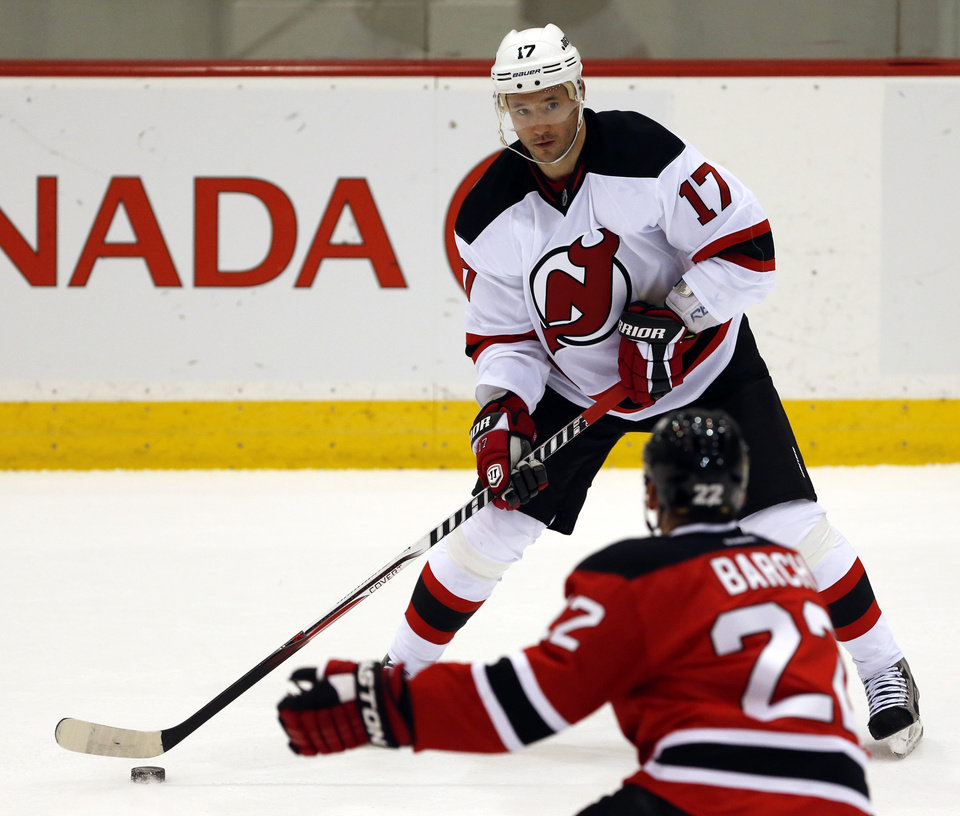 New Jersey Devils left wing Ilya Kovalchuk (17), of Russia, skates with the puck during a scrimmage against the Albany Devils, the team\'s AHL farm team, Wednesday, Jan. 16, 2013, in Newark, N.J. (AP Photo/Julio Cortez)