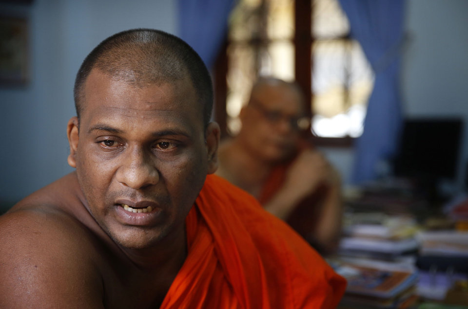 Photo - In this Sunday, Nov. 17, 2013 photo, Galagoda Atte Gnanasara, a 37-year-old Buddhist monk who founded the Bodu Bala Sena (BBS) group, or Buddhist Power Force in 2012, speaks during an interview at BBS office in Colombo, Sri Lanka. With a bloody civil war over and a cautious peace at hand, the group of hardline Buddhist monks is rallying Sri Lankans against what they say is a pernicious threat: Muslims. In just over a year, the saffron-swathed monks of BBS have amassed a huge following, drawing thousands of fist-pumping followers who rail against the country's Muslim minority. (AP Photo/Manish Swarup)