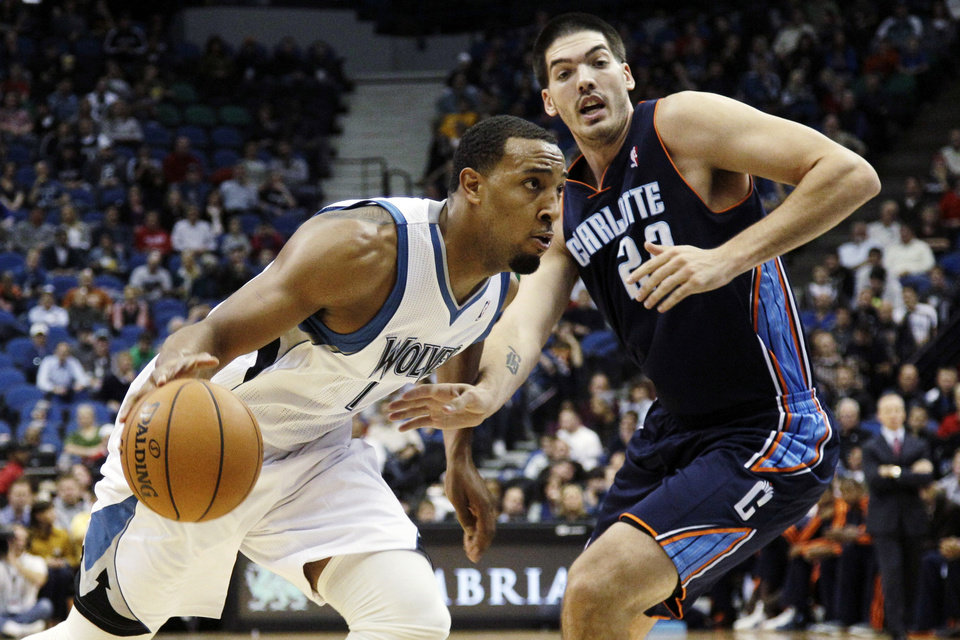 Minnesota Timberwolves' Derrick Williams, left, drives around Charlotte Bobcats' Byron Mullens in the first half of an NBA basketball game, Wednesday, Nov. 14, 2012, in Minneapolis. (AP Photo/Jim Mone)
