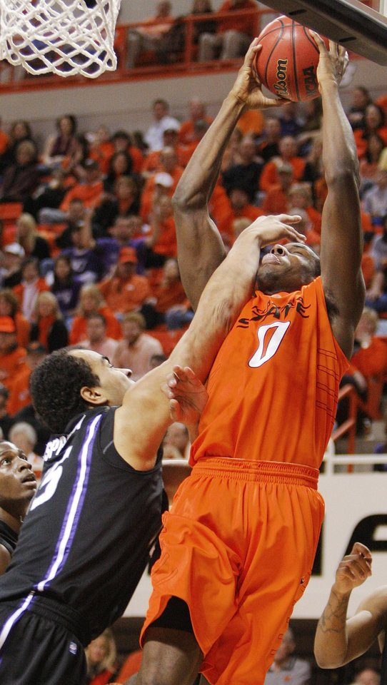 Photo - KSU's Freddy Asprilla (15) fouls Jean-Paul Olukemi (0) of OSU during the men's college basketball game between Oklahoma State University (OSU) and Kansas State University (KSU) at Gallagher-Iba Arena in Stillwater, Okla., Saturday, January 8, 2011. OSU won, 76-62. Photo by Nate Billings, The Oklahoman