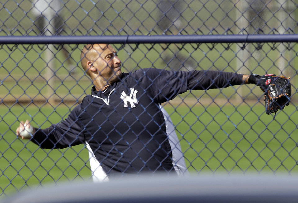 Photo - New York Yankees shortstop Derek Jeter throws during practice at the baseball team's minor league facility  Thursday, Feb. 13, 2014, in Tampa, Fla. (AP Photo/Chris O'Meara)
