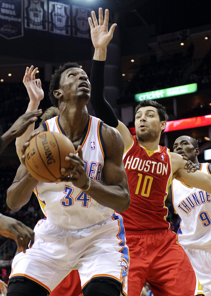 Oklahoma City Thunder's Hasheem Thabeet (34) looks to the basket against Houston Rockets' Carlos Delfino (10) in the first half of an NBA basketball game, Wednesday, Feb. 20, 2013, in Houston. (AP Photo/Pat Sullivan) ORG XMIT: HTR105