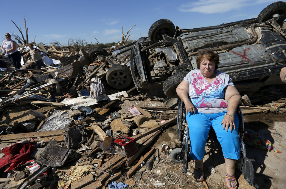 Stella Howard sits as family and friends help sort through her home in the Plaza Towers neighborhood in Moore, Okla., on Wednesday, May 22, 2013. Stella and her husband Howard took shelter in a bathtub as a tornado struck their home on Monday, May 20, 2013. The couple also had their home destroyed by the May 3, 1999 tornado in Midwest City. Photo by Bryan Terry, The Oklahoman