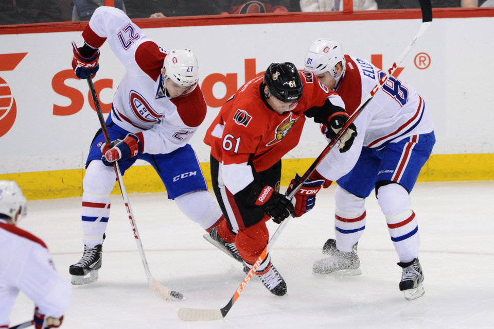Ottawa Senators' Andre Benoit (61) tries to get to the puck through Montreal Canadiens' Alex Galchenyuk (27) and Lars Eller (81) during the first period of their NHL hockey game, Monday, Feb. 25, 2013, in Ottawa, Ontario. (AP Photo/The Canadian Press, Sean Kilpatrick)