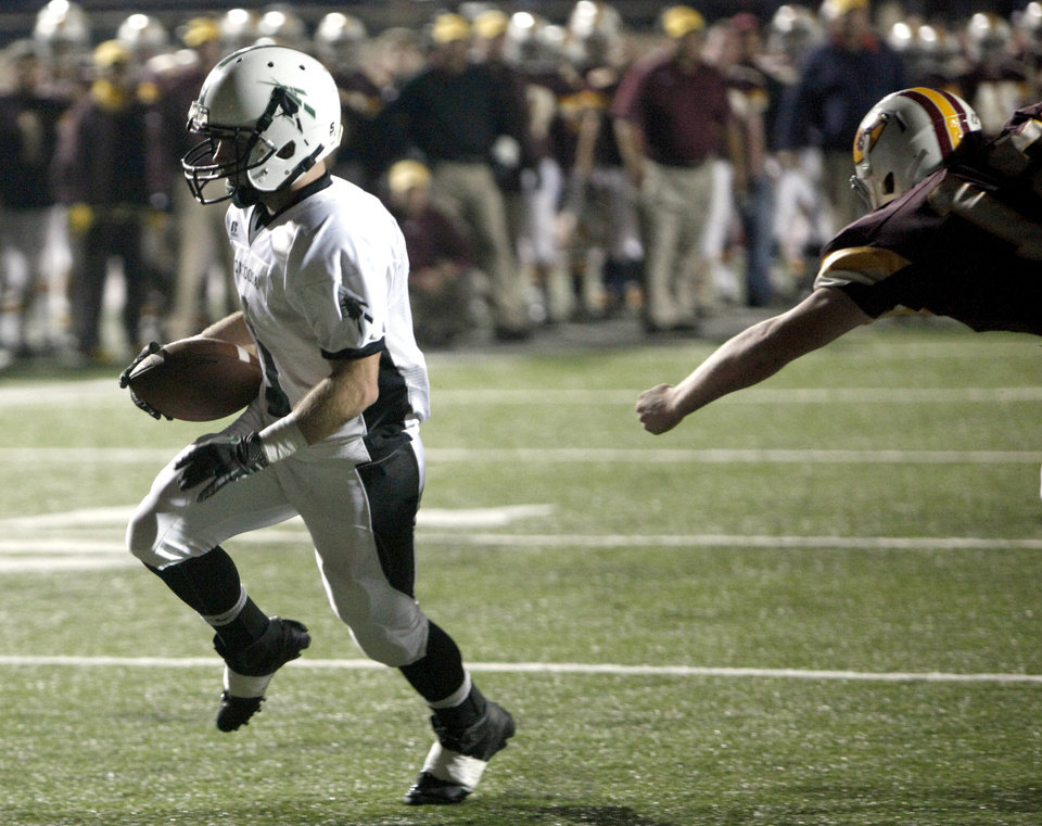 Photo - Catoosa's Cole Scheulen scores a touchdown during the 4A Class high school football playoff game between Clinton and Catoosa at Putnam City High School.,  Friday, Nov. 25, 2011.  Photo by Sarah Phipps, The Oklahoman