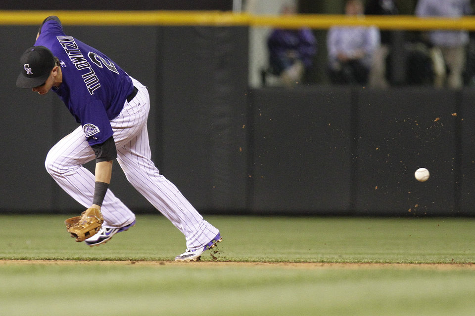 Photo -   Colorado Rockies shortstop Troy Tulowitzki (2) misses a grounder by Los Angeles Dodgers' James Loney during the sixth inning of a baseball game Tuesday, May 1, 2012 in Denver. The Dodgers won 7-6. (AP Photo/Barry Gutierrez)