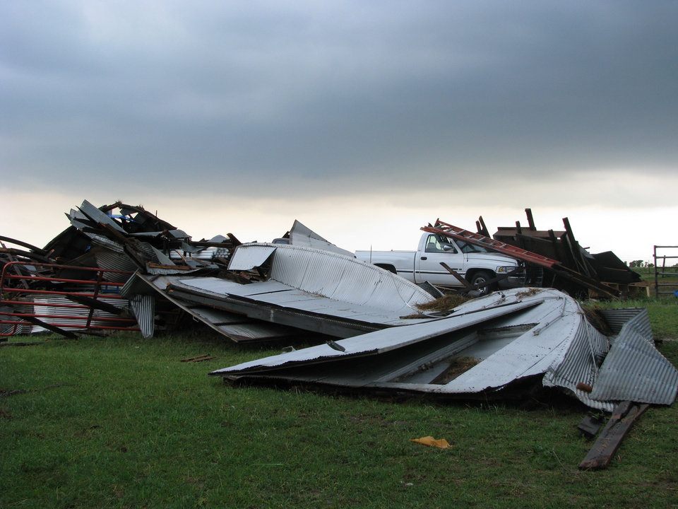 Photo - Debris from a shed and a stable cover Jerry Taylor's yard south of Covington. Taylor's house, on Bison Road a mile east of State Highway 74, was heavily damaged and two horses are missing, but Taylor, 55, was not hurt. By Michael Kimball