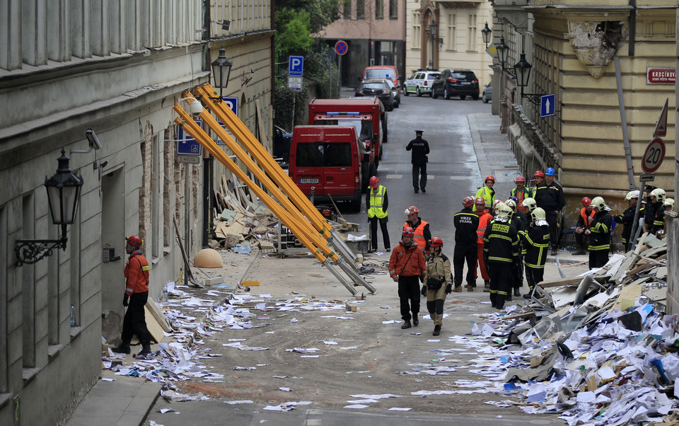 Photo - Rescue workers inspect a scene of a gas explosion downtown Prague, Czech Republic, Monday, April 29, 2013. A powerful explosion badly damaged an office building in the center of the Czech capital Monday, injuring up to 35 people. (AP Photo/Petr David Josek)