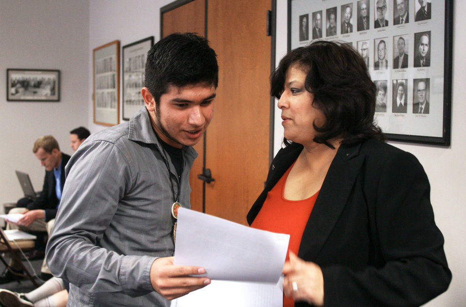 University of Texas student Roberto Flotte, left, and state Rep. Norma Chavez, D-El Paso, talk after Chavez asked the State Board of Education to require curricula including more Hispanic figures at a hearing on new social studies curriculum standards on Wednesday in Austin, Texas. AP Photo