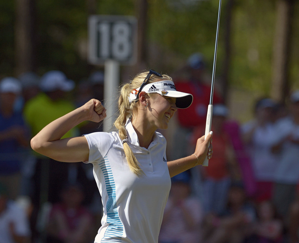 Photo - Jessica Korda reacts after sinking a putt on the 18th hole to win the Airbus LPGA Classic golf tournament at Magnolia Grove on Sunday, May 25, 2014, in Mobile, Ala. (AP Photo/G.M. Andrews)