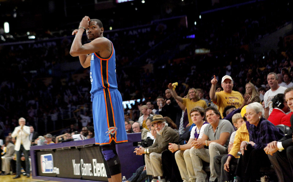 Photo - Lakers' fans react to Oklahoma City's Kevin Durant (35) during Game 4 in the second round of the NBA basketball playoffs between the L.A. Lakers and the Oklahoma City Thunder at the Staples Center in Los Angeles, Saturday, May 19, 2012. Photo by Nate Billings, The Oklahoman