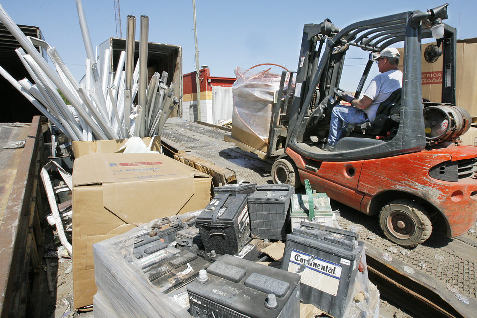 Photo -  Copper prices rose slightly last week as a strong U.S. economic report prompted expectations of growing demand for the many products that use copper. In this photo, a worker at a south Oklahoma City metal recycling business uses a forklift to load copper wire. [Photo by David McDaniel, The Oklahoman Archives]