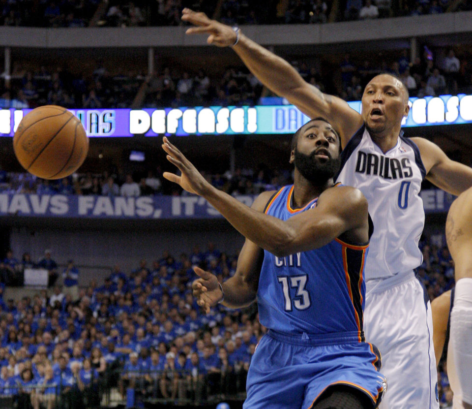 Photo - Oklahoma City's James Harden (13) passes the ball beside Shawn Marion (0) of Dallas during game 5 of the Western Conference Finals in the NBA basketball playoffs between the Dallas Mavericks and the Oklahoma City Thunder at American Airlines Center in Dallas, Wednesday, May 25, 2011. Photo by Bryan Terry, The Oklahoman