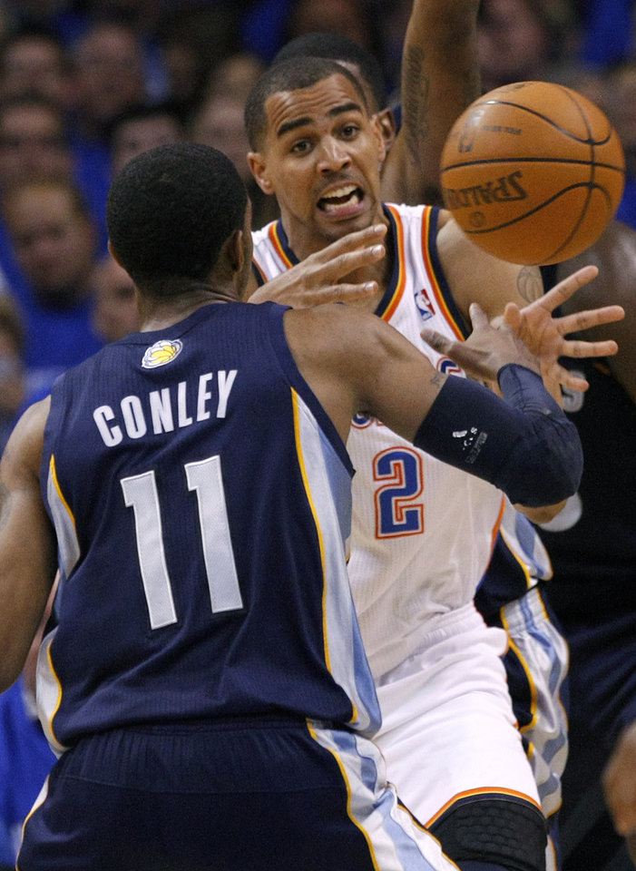 Photo - Oklahoma City's Thabo Sefolosha (2) looses the ball to Memphis' Mike Conley (11) during game one of the Western Conference semifinals between the Memphis Grizzlies and the Oklahoma City Thunder in the NBA basketball playoffs at Oklahoma City Arena in Oklahoma City, Sunday, May 1, 2011. Photo by Chris Landsberger, The Oklahoman