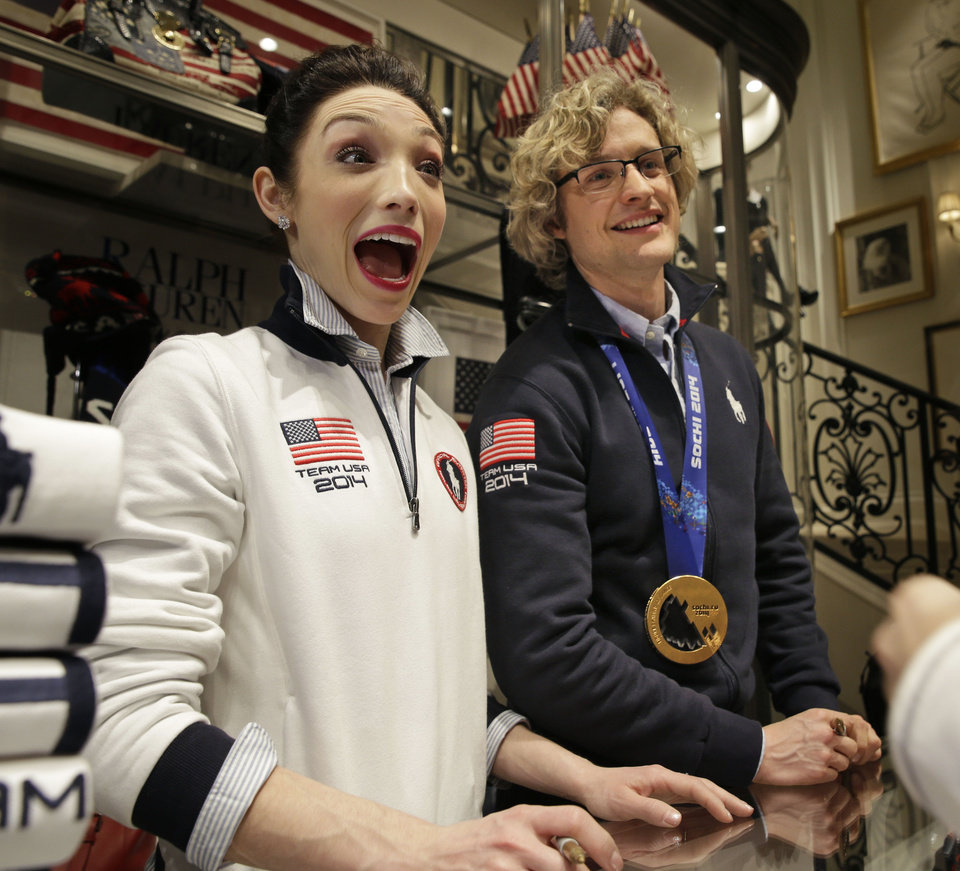Photo - Olympic figure skating gold medalists Meryl Davis and Charlie White talk to fans while signing autographs in New York, Wednesday, Feb. 26, 2014. (AP Photo/Seth Wenig)