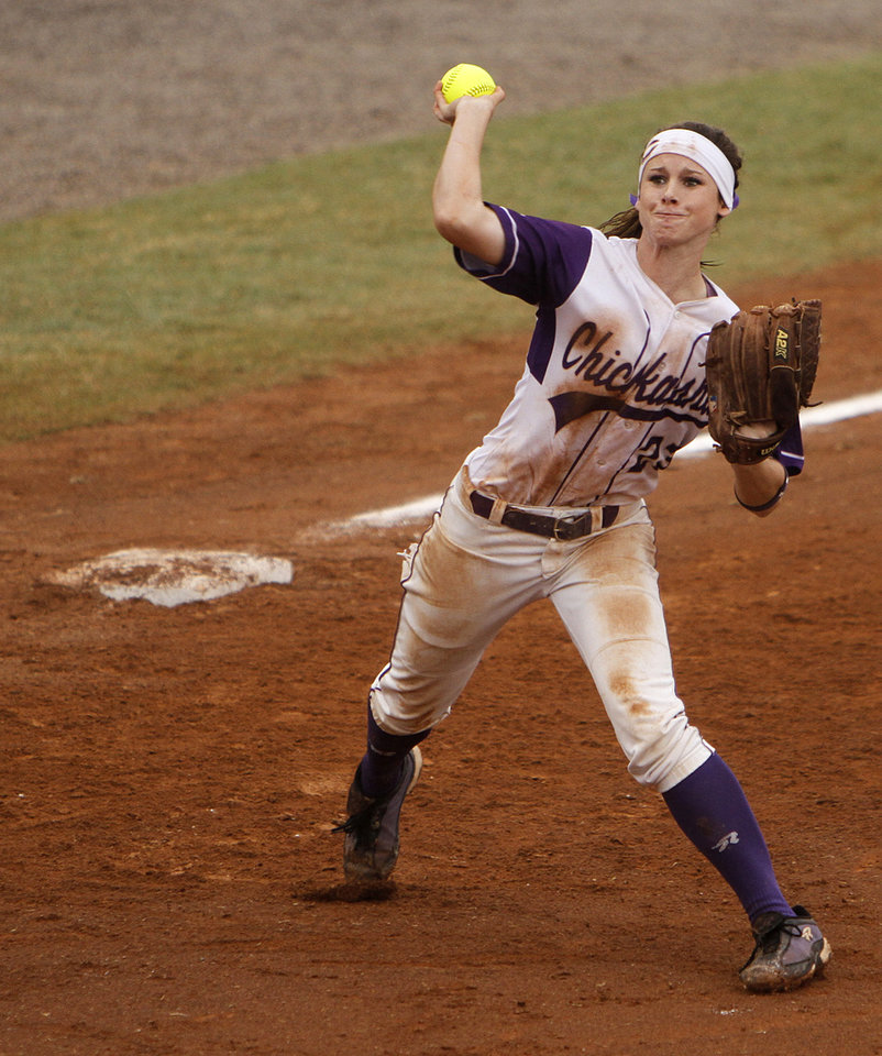Chickasha's Brooklin Burns (23) throws a ball from third base during a 5A state softball semifinals game between Edmond North and Yukon at ASA Hall of Fame Stadium in Oklahoma City, Okla., Friday, Oct. 12, 2012.  Photo by Garett Fisbeck, The Oklahoman